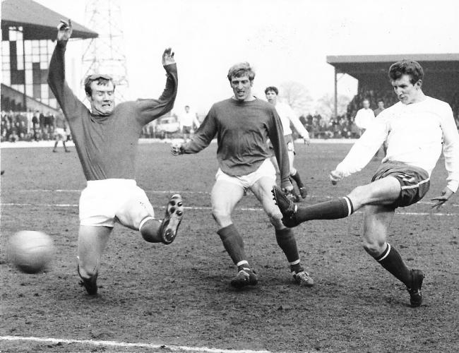 Bobby Owen gets in a left-footed shot to beat Reading's Mike Dixon in a 2-0 win for Bury