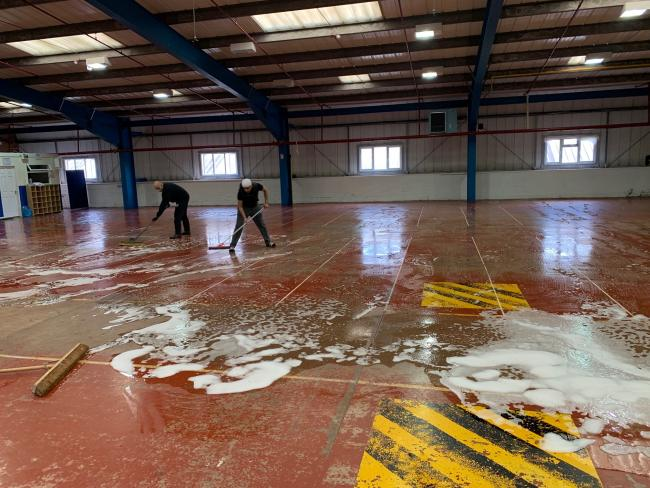 DEEP CLEAN: Volunteers helping to clean the Masjid E Ghosia mosque to help turn it into a community hospital