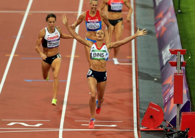 The Bolton News: GOLD: Great Britain's Jessica Ennis celebrates winning the Heptathlon, after the 800m event during day eight of the London 2012 Olympic Games at the Olympic Stadium, London. Picture: PA Wire