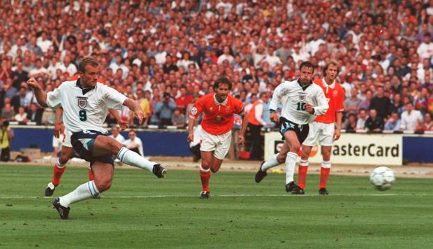 The Bolton News: GOAL: Alan Shearer scores from a penalty to open the scoring for England in tonight's Euro 96 clash against Holland at Wembley. Picture: Neil Munns/PA