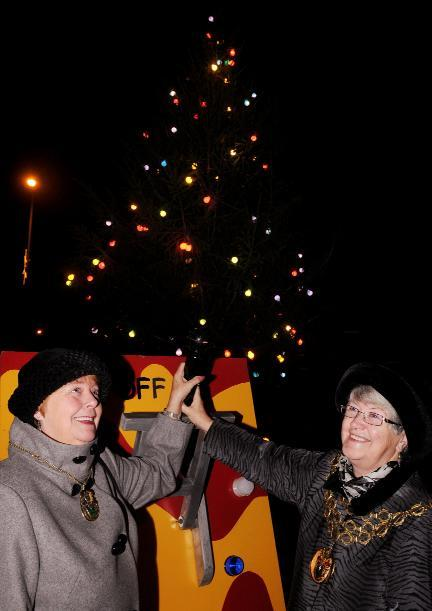 LIGHTS ALIVE: The Town Mayor of Horwich, Cllr Sue Denton, right, and Town Mayoress, Shirley Garland switch on the Christmas lights