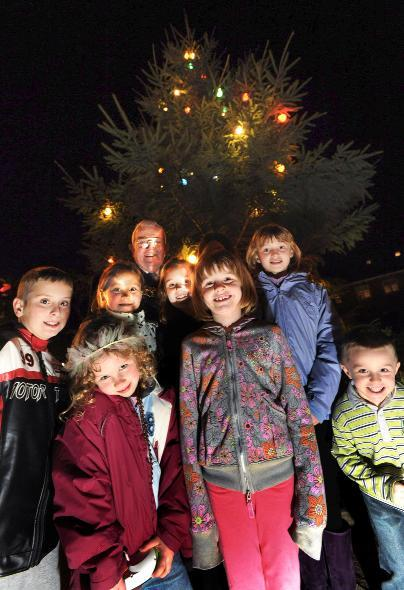 LIGHT-UP: Cllr Norman Critchley with children including, front, Nathan O'Hara, Kiera Robinson, Isabel Regent and Joseph Regent at Dunscar