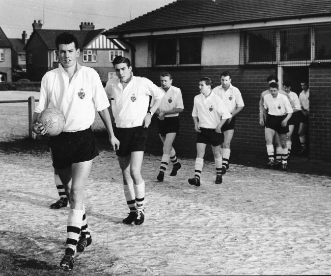 John Napier leads the Under-18s team out at Bromwich Street in January 1963