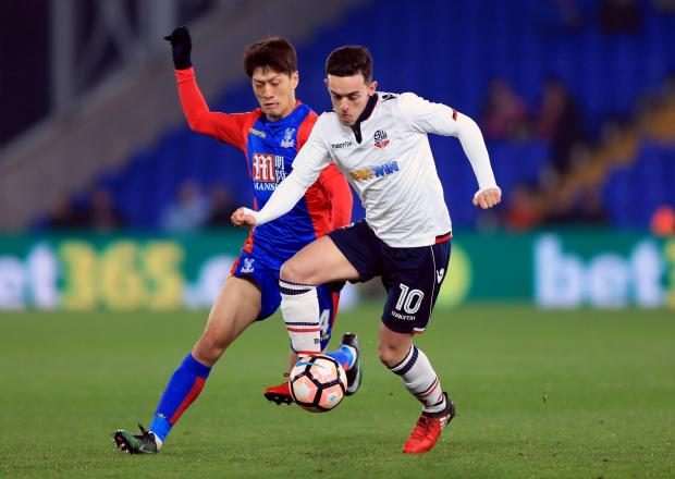 The Bolton News: Zach Clough tangles with Crystal Palace's Chung-Yong Lee