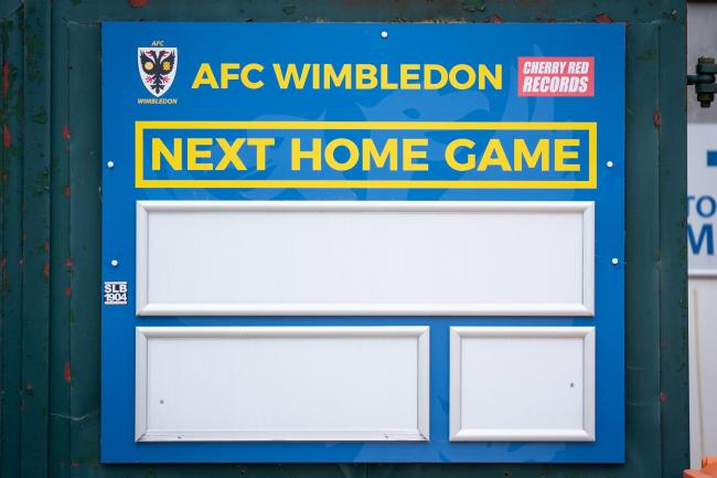 A view of a blank 'next home game' sign at the Cherry Reds Record Stadium, home to AFC Wimbledon.