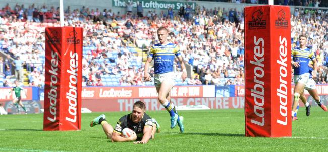 Action from the Challenge Cup semi-finals at Wanderers