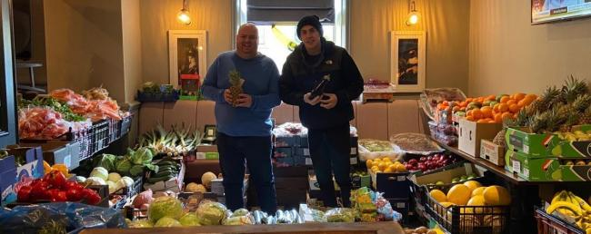 LANDLORDS: George Campbell and Daniel Dunne at the community shop