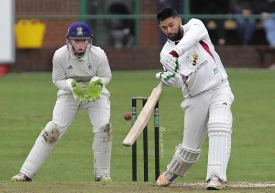 DERBY DAY: Farnworth batsman Umer Ishaq goes on the attack with Farnworth Social Circle's Max Perry hoping for a chance. Pictures: Harry McGuire