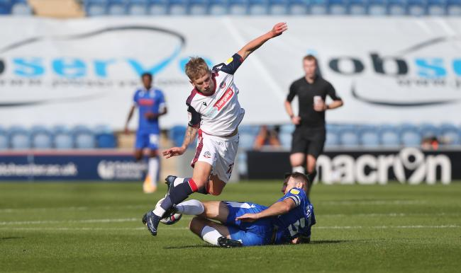 Jak Hickman is felled in Wanderers' 2-0 defeat at Colchester