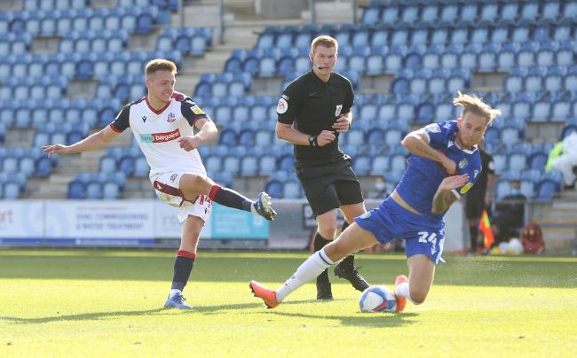 Tom White sees a shot blocked against Colchester