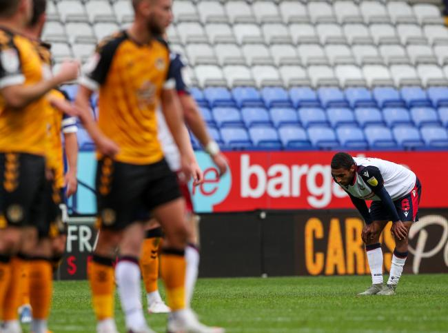 Brandon Comley looks dejected after Wanderers' defeat against Newport