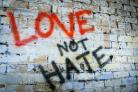Graffiti reading 'Love not Hate' (Picture: PA)