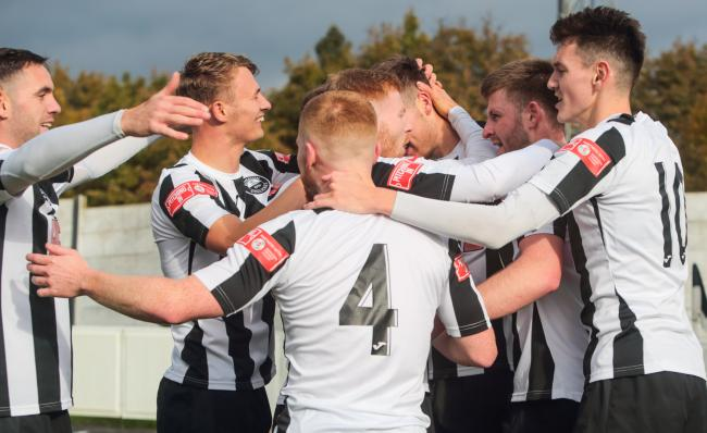 Atherton Colls celebrate their goal against Stalybridge. Picture: Dave Featherstone