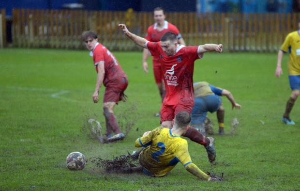 The Bolton News: Atherton Colls managed 50 minutes in awful conditions on Saturday. Picture: James Lobley