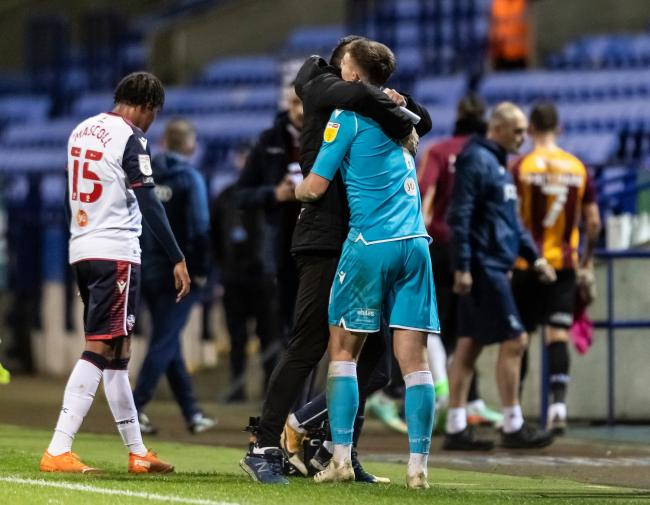 Billy Crellin is congratulated by goalkeeper coach Matt Gilks after the win against Bradford.