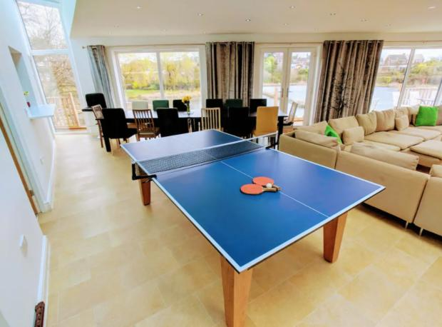 The Bolton News: This property has a games room (Photo: Airbnb)