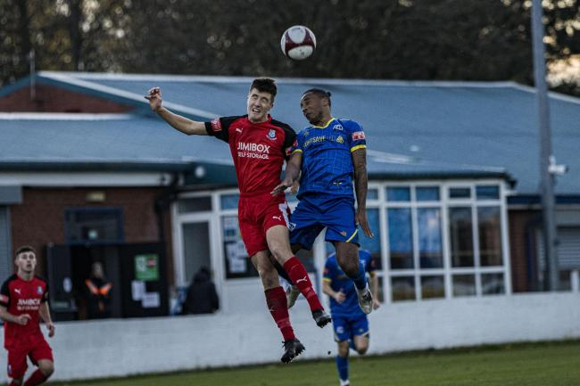 Neil Danns in action for Radcliffe against Wanderers' George Thomason, during his loan spell at Bamber Bridge. Picture: Haydan Roberts