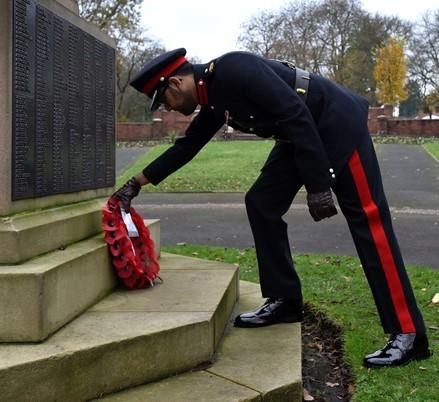 TRIBUTE: Deputy Lord Lieutenant Saeed Atcha left a wreath at Farnworth's war memorial