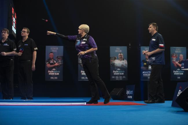 Lisa Ashton in action against Krzysztof Ratajski on Tuesday night. Picture: Lawrence Lustig/PDC