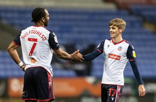 Nathan Delfouneso and Ronan Darcy celebrate the 3-0 win against Southend United.