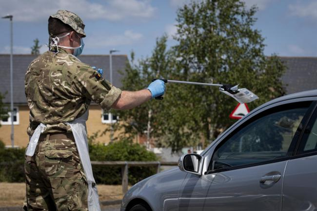 A soldier from 3rd Battalion The Royal Anglian Regiment.Essex Reservists carries covid testing packs to be placed in a refrigeration unit prior to be sent off for testing