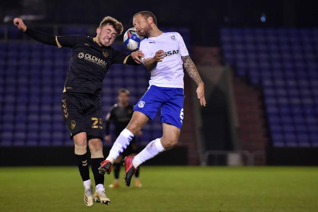 Jay Spearing (right) in action for Tranmere against Oldham
