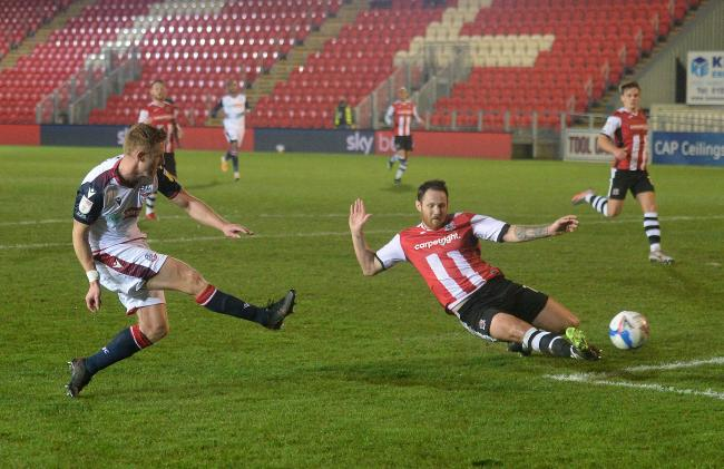 Eoin Doyle strikes at goal in Wanderers' 1-1 draw at Exeter City