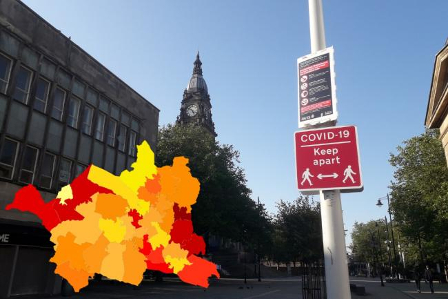 Covid-19 infections reported in each area pictured in front of Bolton Town Hall