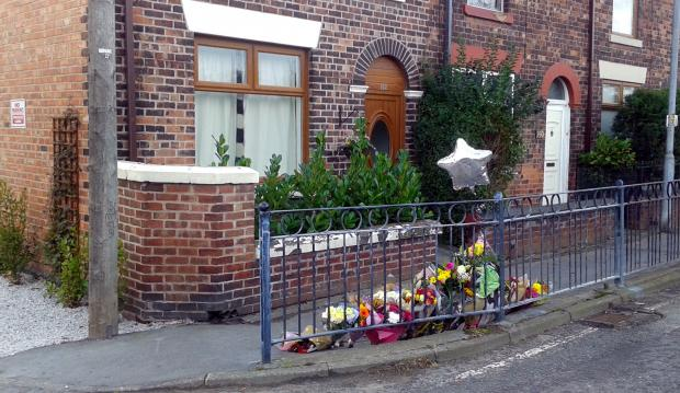 The Bolton News: Flowers left at the scene of the murder of Michael Blake on Wigan Road, Westhoughton.