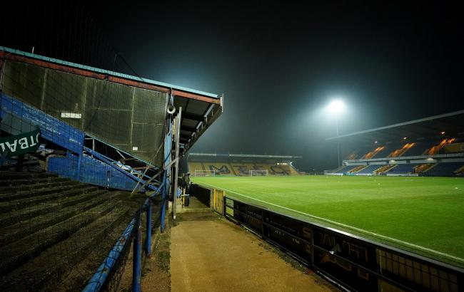 Wanderers were due to face Mansfield at the One Call Stadium tonight