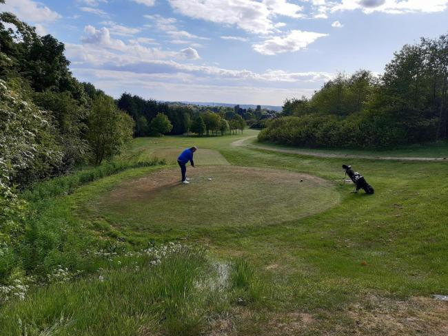 FORE: A player preparing to take a shot on the course at Harwood Golf Club