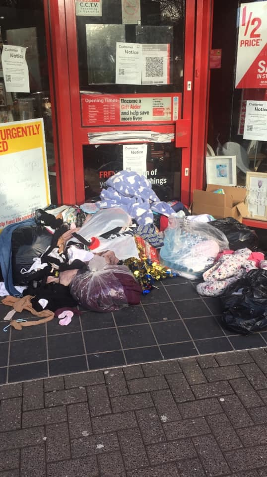 Bags are being left outside the Darwen branch of the British Heart Foundation charity shop - volunteers say people are ignoring the signs and need to stop leaving them there