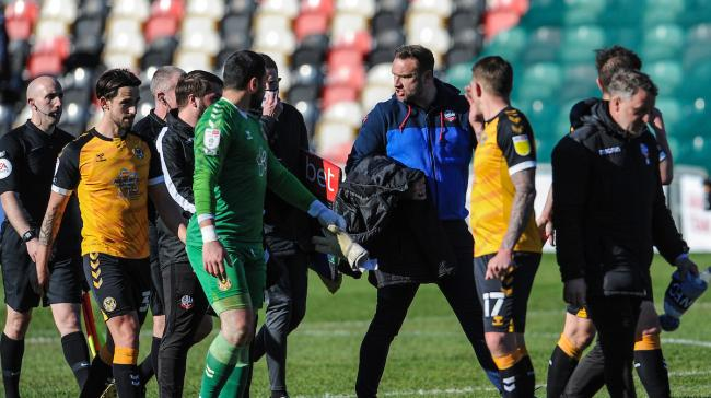 Ian Evatt speaks to the officials after the 1-0 defeat at Newport