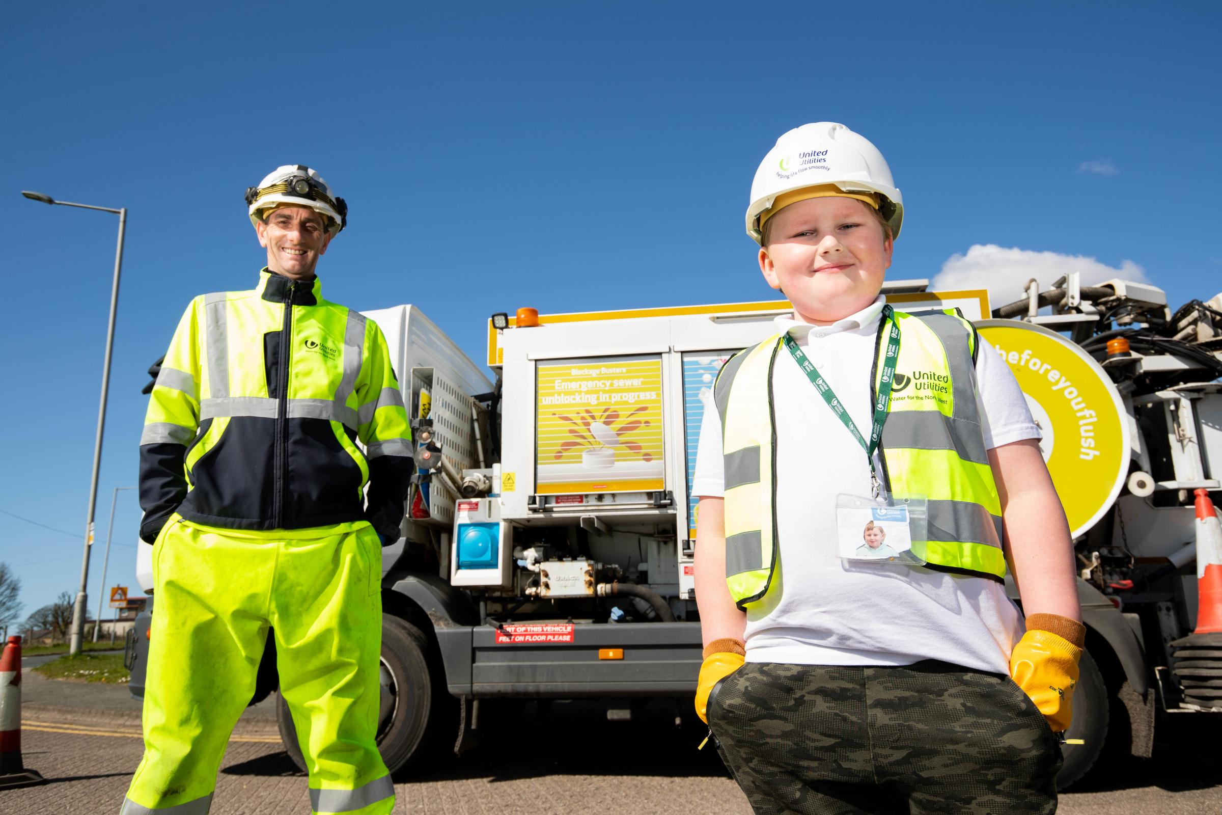 : Star of Channel's Sewerman Ste Iveson and United Utilities' fan Oscar Pickering sporting his home-made lanyard.