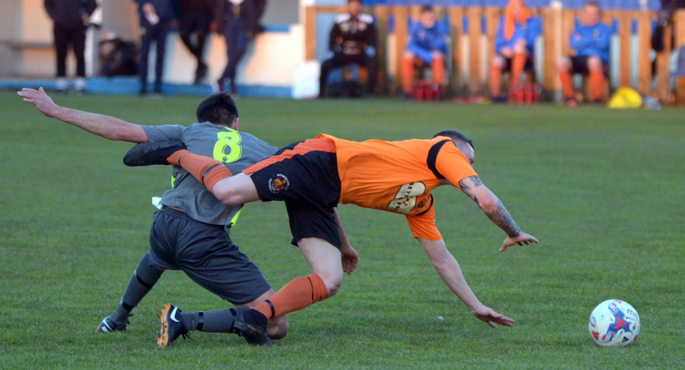 Action from the meeting between Atherton LR, in orange, and Atherton Town in the Bolton Hospital Cup. Picture: James Lobley