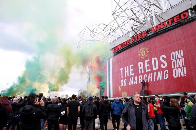 Manchester United fans outside Old Trafford on Sunday (Picture: PA)