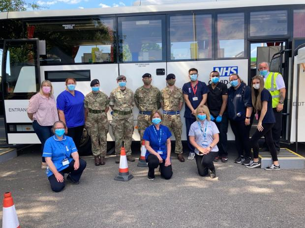 The Bolton News: Volunteers with the vaccine bus in Farnworth