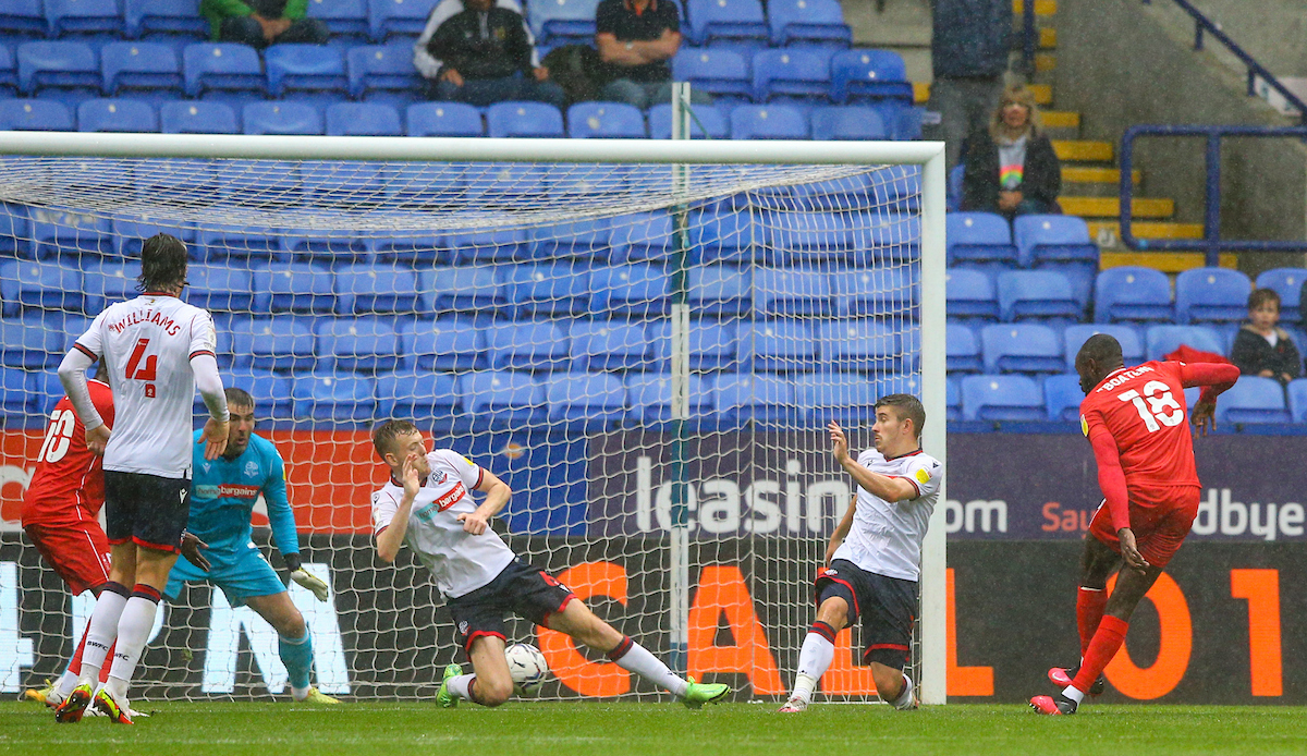 Bolton Wanderers players protesting refereeing decisions in MK Dons thriller