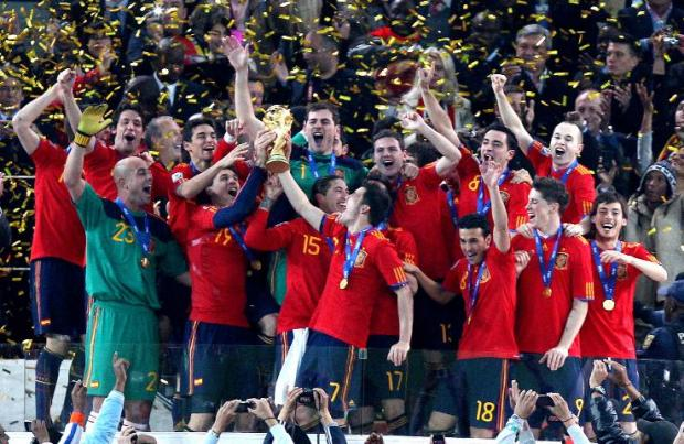 CELEBRATION TIME: Spain's players show their delight after being presented with the World Cup last night