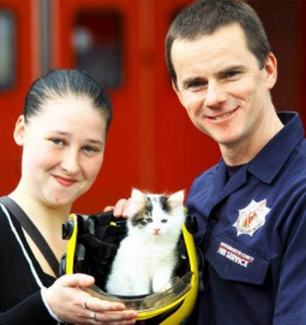 SAFE AND SOUND Nikita Marsh with Misty the kitten and her saviour Firefighter John Naylor