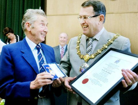 Ron Hill receives the Freeman of the Borough award from Mayor John Broadley