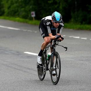 Bradley Wiggins extended his Tour de France lead on Thursday