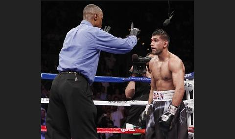 Amir Khan suffers crushing defeat