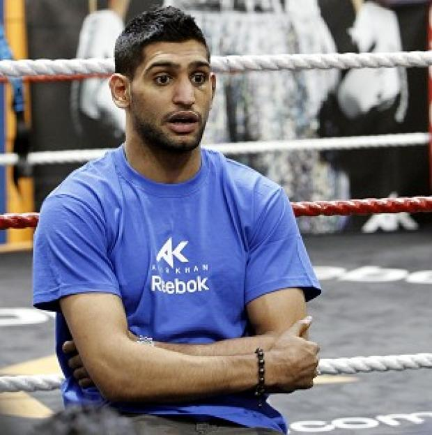 Amir Khan's trainer Freddie Roach is hopeful 'Danny Garcia will come to England and maybe fight us over there'