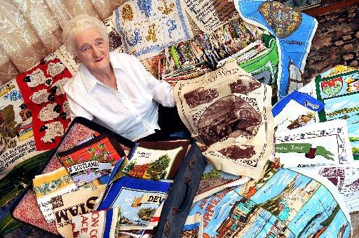 The Bolton News: Phyllis Newnham with her collection of tea towells