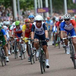 The Bolton News: Mark Cavendish crosses the finish line in the men's road race