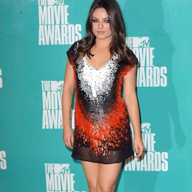 Mila Kunis has reportedly headed off for a romantic break with Ashton Kutcher