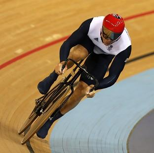 Sir Chris Hoy has reached the second round in the keirin