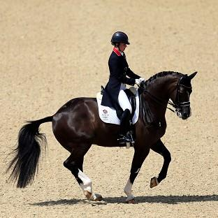 Charlotte Dujardin, pictured, Carl Hester and Laura Bechtolsheimer won dressage team gold