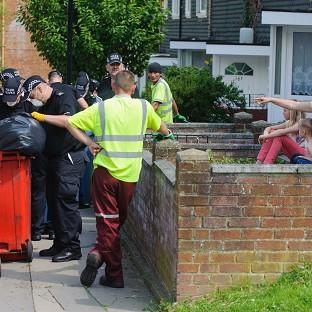 Polce have sealed off an area around Tia Sharp's grandmother's house in south London